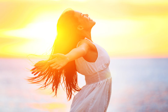 Enjoyment - free happy woman enjoying sunset. Beautiful woman in